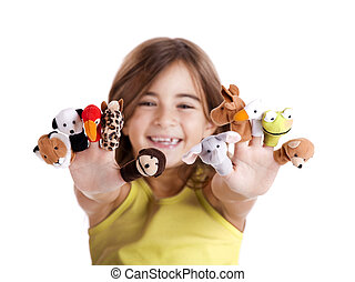 Playing with finger puppets - Cute and happy girl playing...