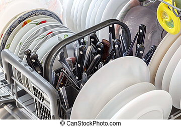 Clean dishes after washing in the dishwasher. Close up