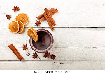 mulled wine with spices on white wooden table. top view copy space