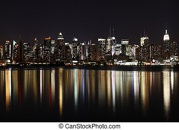 Midtown West Side Manhattan at night panoramic photo made of...
