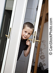 Little Boy by the door - Little Boy looking out from the...