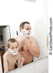 Father and Son Shaving - Happy Mature Man shaving in...
