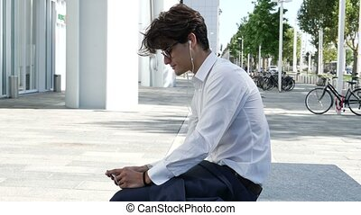 Stylish Young Business Man with Earphones - Stylish Young...