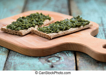 Green chimichurri sauce served on rye crackers. Low calorie...