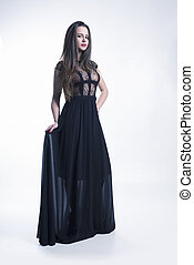 Young model with elegant black dress
