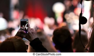 Closeup view of a girl filming a dance on her smartphone....