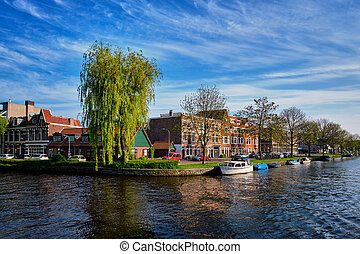 Boats, houses and canal. Harlem, Netherlands - Boats and...