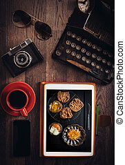 Food blog concept with sweet cookies on tablet pc on wooden...