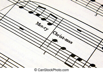 Christmas Music - Merry Christmas text on a sheet of music....