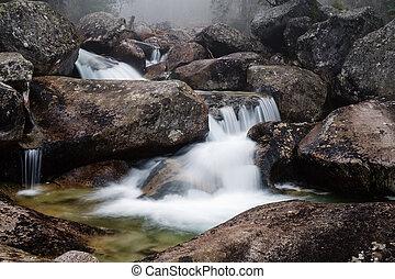 Waterfall of Studeny potok stream, Slovakia - Foggy day near...