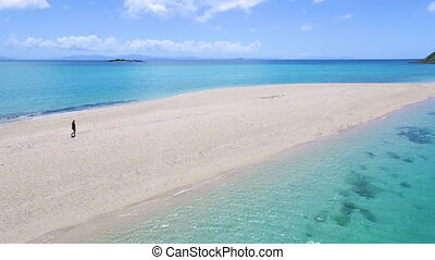 Mountains and ocean and sandbar - An aerial shot of the sand...