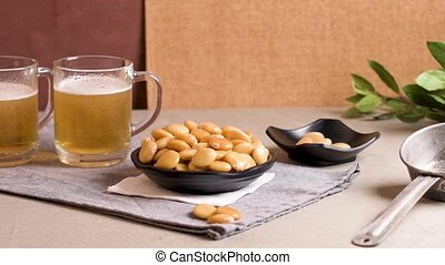 Tasty lupins and glass of beer - Tasty lupins in metal mug...