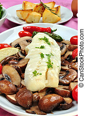 cod loins with organic mushroom on a plate