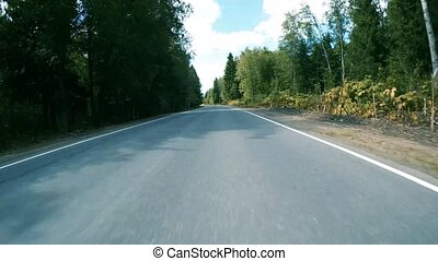Driving on asphalt roads in summer