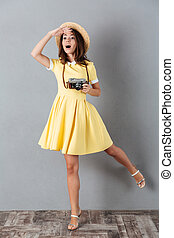 Lovely girl posing on one leg and looking far away - Lovely...