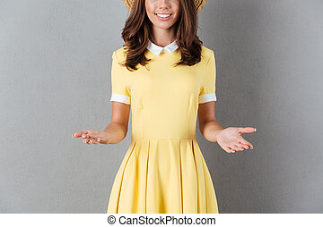 Cropped image of a smiling girl with outstretched hands -...