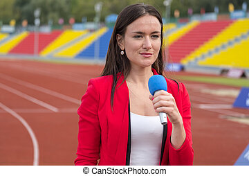 Journalist is reporting from the stadium for TV show -...