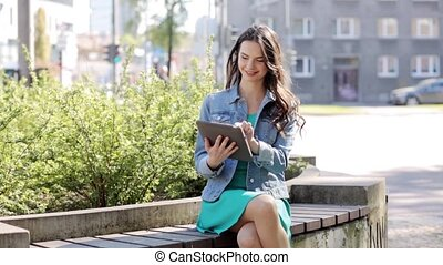 happy young woman or teenage girl with tablet pc -...