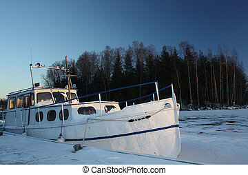 Winter boat in frozen lake