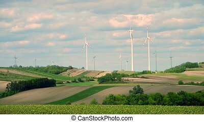 Distant wind turbines and fields in Austria - Wind...