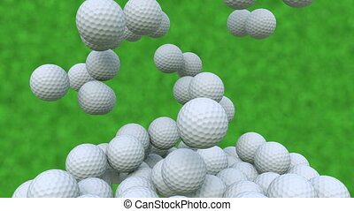 Multiple golf balls falling down against green grass...