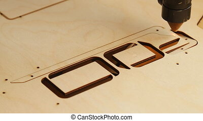 Laser cutting of wood or plywood