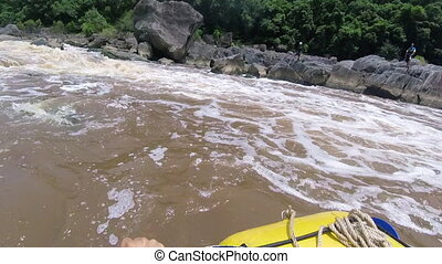 Rowing boat on an unstable current - A medium shot of the...
