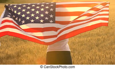 female young woman holding an American USA Stars and Stripes...