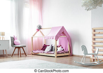 Girls bedroom with rocking horse