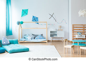 Colorful kids bedroom with kites - Drop shaped pillow on...