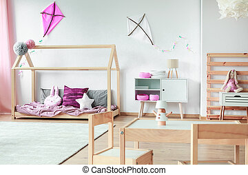 Child bedroom with handmade toys - Wooden bed with pink...