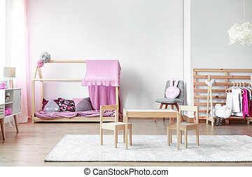 Girls bedroom with table and chairs