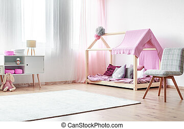 Charming girls bedroom with rocking horse handmade bed with...