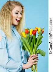 Pretty woman with red yellow tulips bunch - International...
