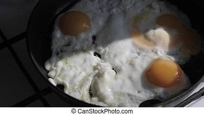 fried eggs in a frying pan