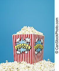 Basket of Popcorn on blue background