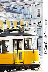 portugese tramcar - a yellow and white tramcar in Lisbon,...