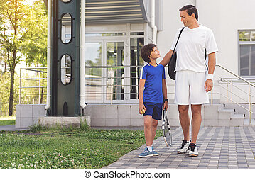Happy smiling family ready for sport - Confident son is...