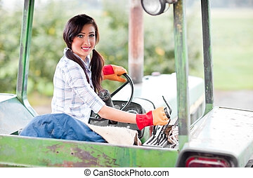 Farm girl - A shot of a girl riding a tractor in a farm