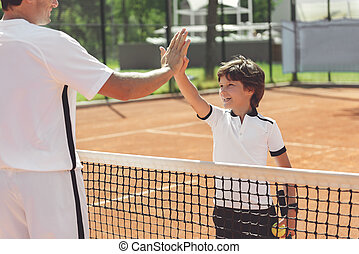 Hilarious laughing boy and man ready for tennis - Cheerful...