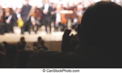 Close up of man hands applauding at concert hall of the...