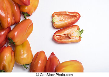sweet pepper cut into halves on a white background close-up