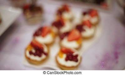 Capkake with a slice of strawberry and currant berries. On...