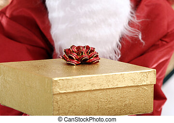 Santa clause with yellow present box in his hands