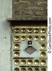 Italian door bells - grid of brass doorbells