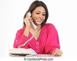 woman talking over telephone
