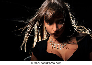 Attractive young fashion model over black background