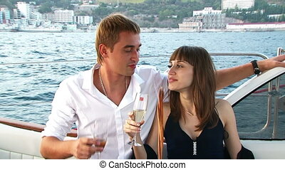 Romantic date - Young couple drinking champagne for a...