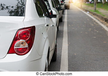 Car tail lights - cars in a tourist traffic jam on road.