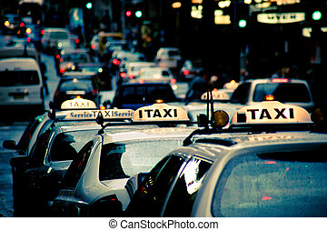 Taxis - A row of taxis on a rainy day